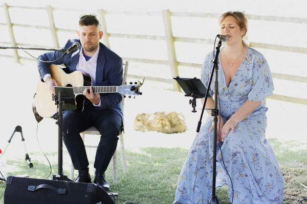 Electric Outfit Duo performing at wedding ceremony