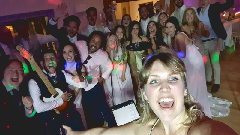 Wedding reception selfie with band and guests