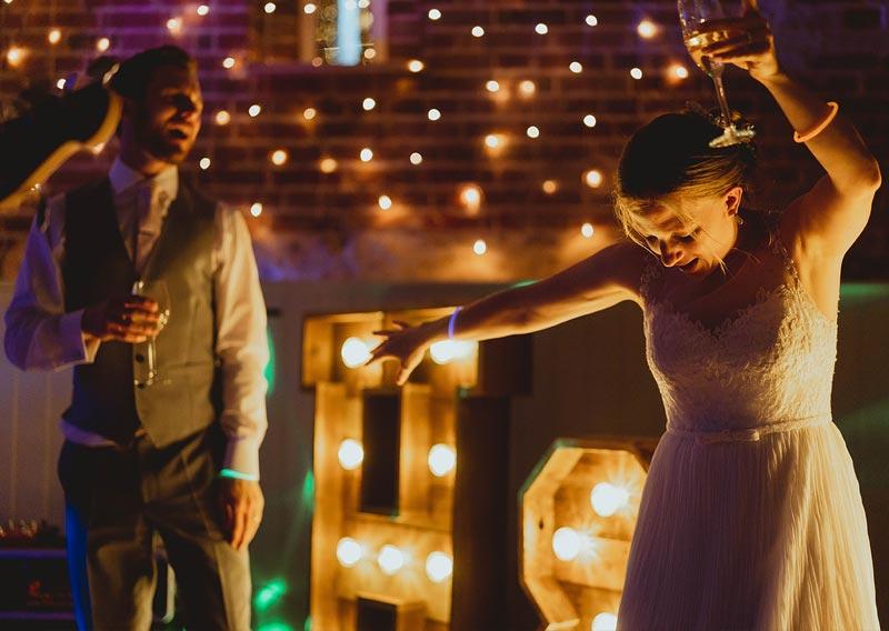 Bride & Groom dancing on stage at wedding reception