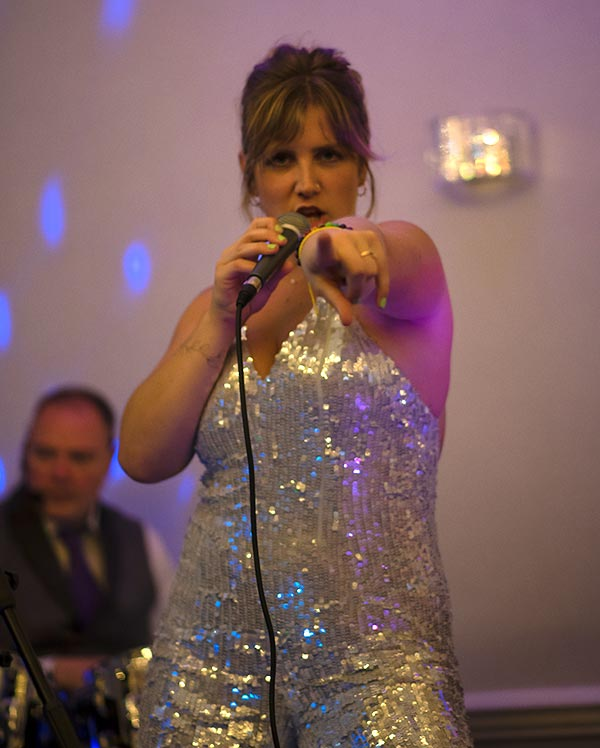 Charlotte on stage at The Swan in Westgate, Kent - pointing at camera